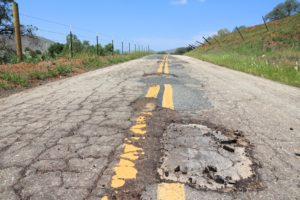 Damaged roadway dangerous road conditions lawyer